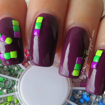 Plum with neon studs nail art by bydanijela