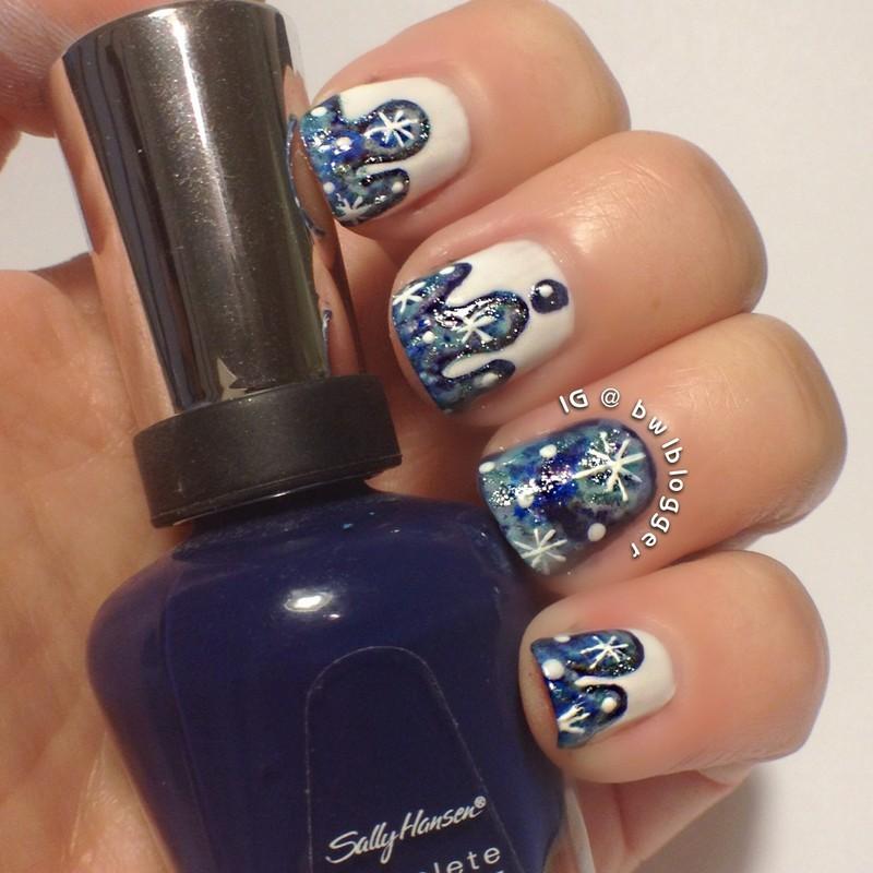Dripping galaxies nail art by Ashley