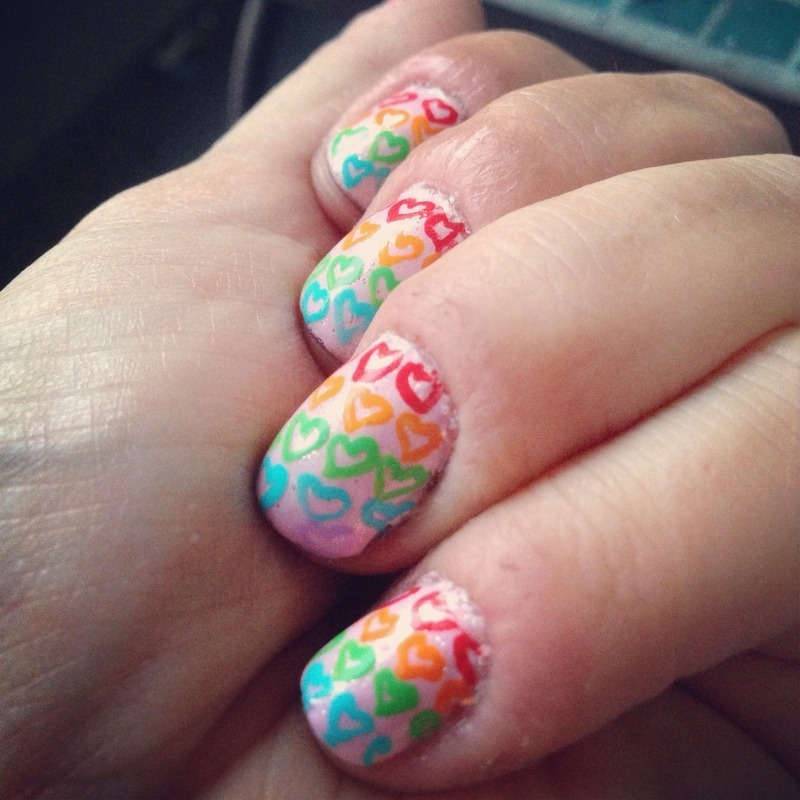 Rainbow Hearts nail art by Megan Lagerson