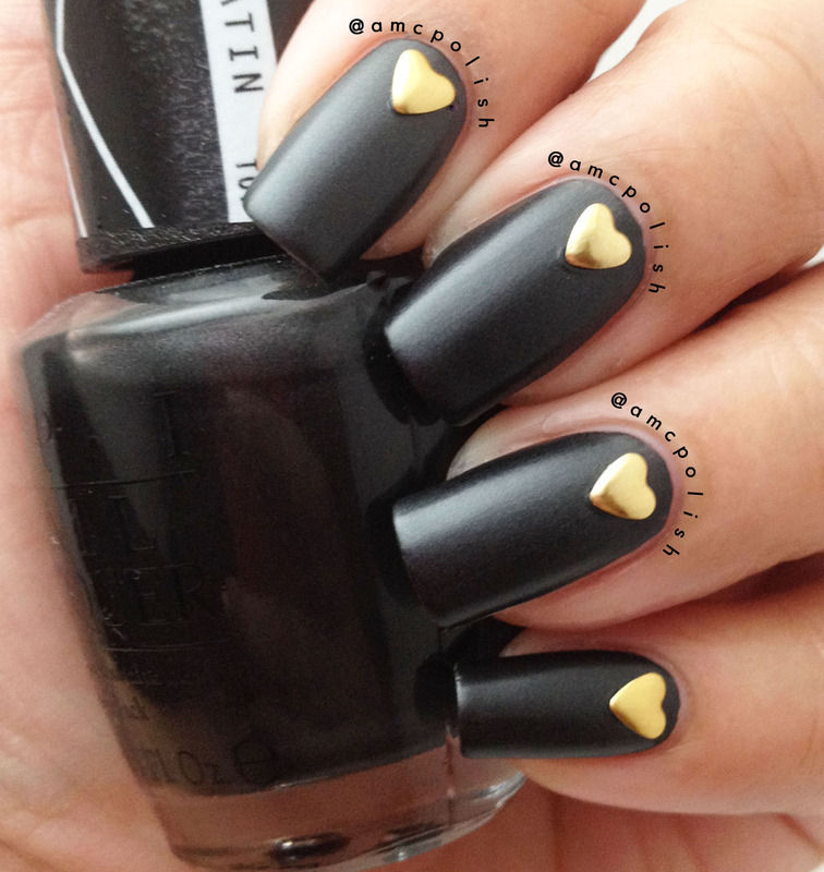 Satin Black with Heart Studs nail art by Amber Connor