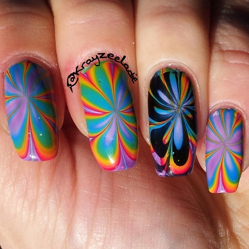 Rainbow Watermarble nail art by Amy