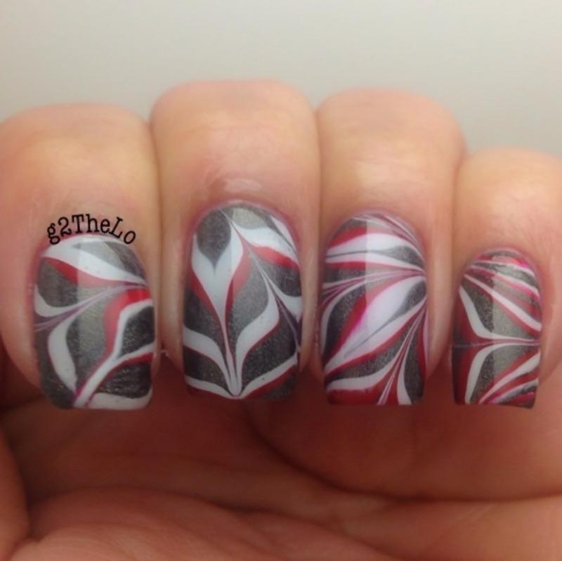 Water marble nail art by Gloria  Loeza