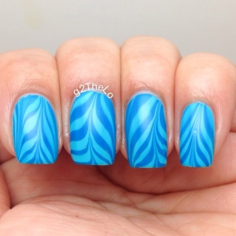 Blue water marble nail art by Gloria  Loeza