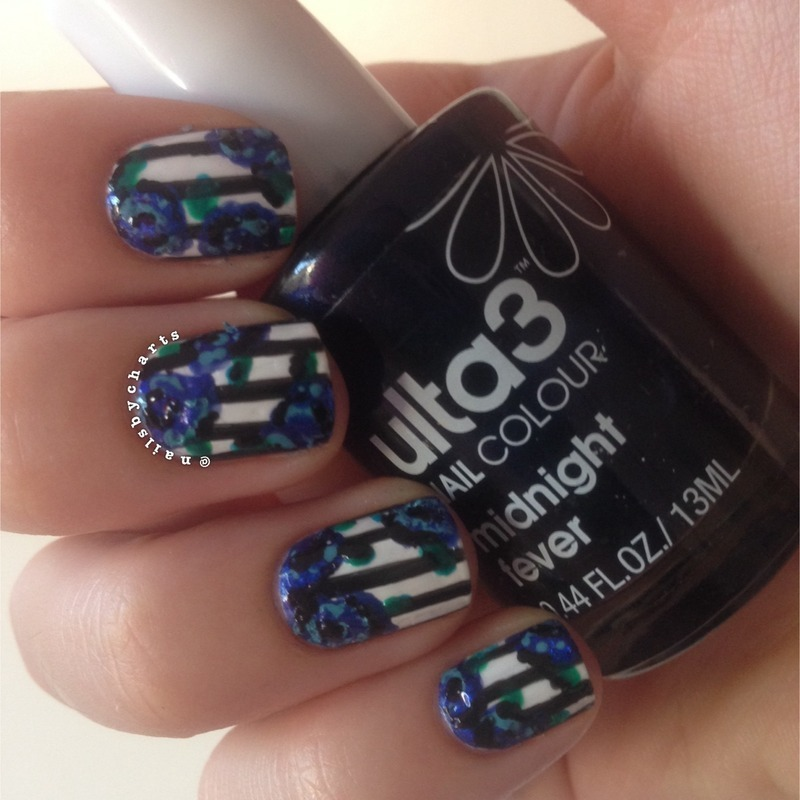 Striped floral nail art by Claudia