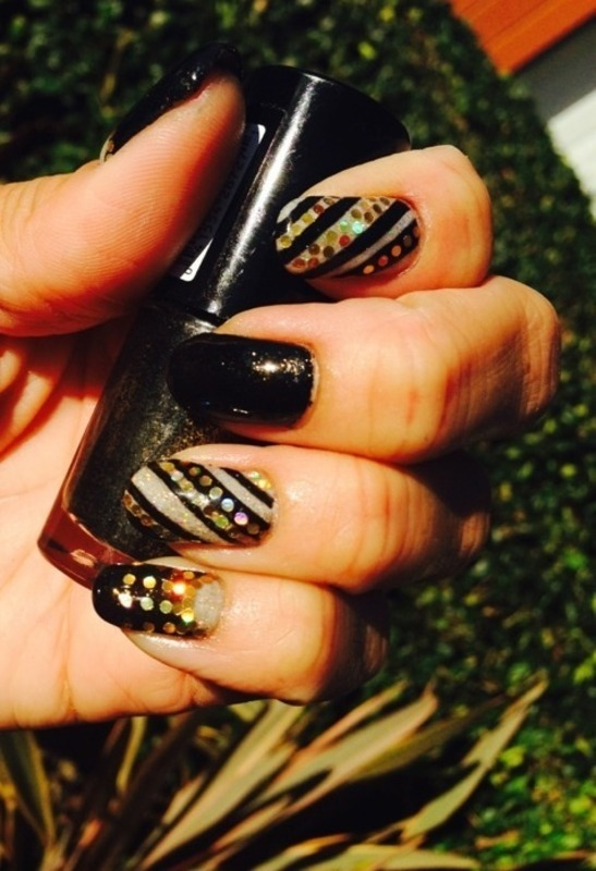 Black & Gold with glitter placement nail art by Genevieve  Clay-Poor