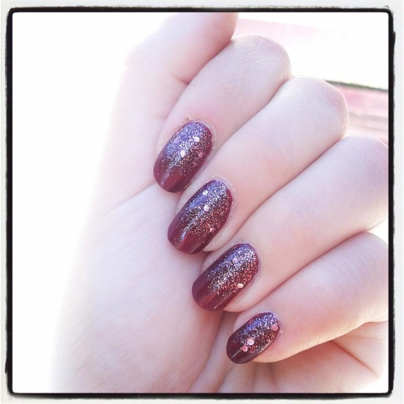 With glitter nail art by Kinga