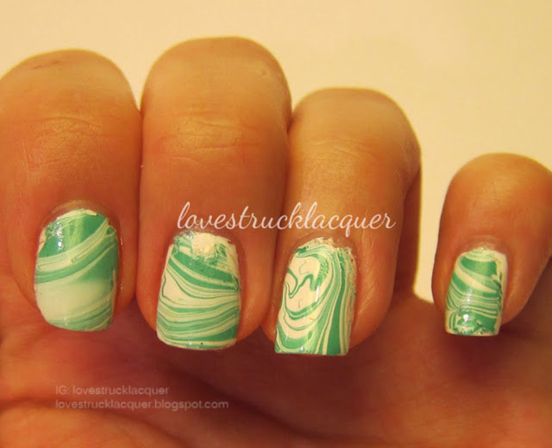 Green and white watermarble nail art by Stephanie L