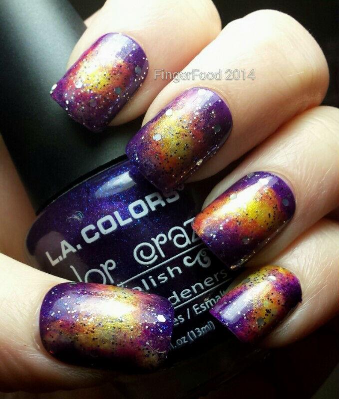 Pink/purple Galaxy nail art by Sam