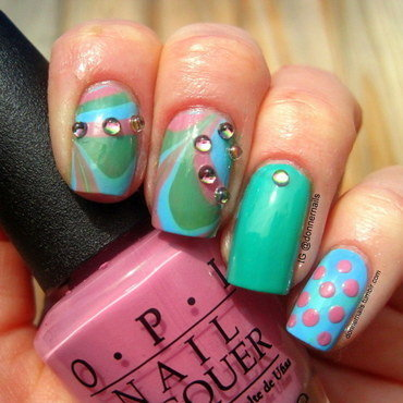 Watermarble with studs nail art by Donner