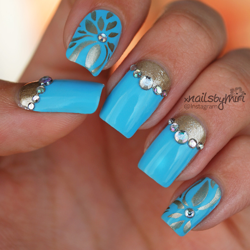 Baby Blue & Gold nail art by xNailsByMiri