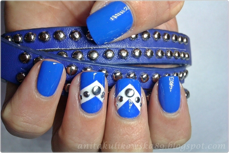 Triangle nails with studs nail art by Anita
