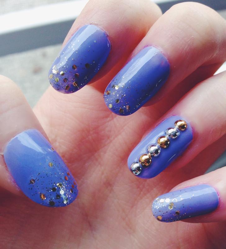 Glitter and Studs nail art by Anya Qiu
