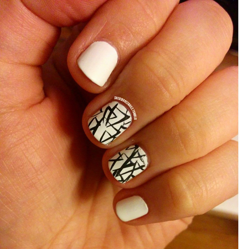 Freehand Triangles nail art by moon doggo