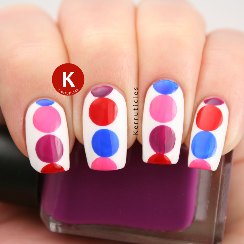 Pink, red, purple and blue large circles nail art by Claire Kerr