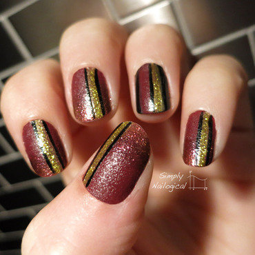 Red leather with gold and black stripes nail art by simplynailogical