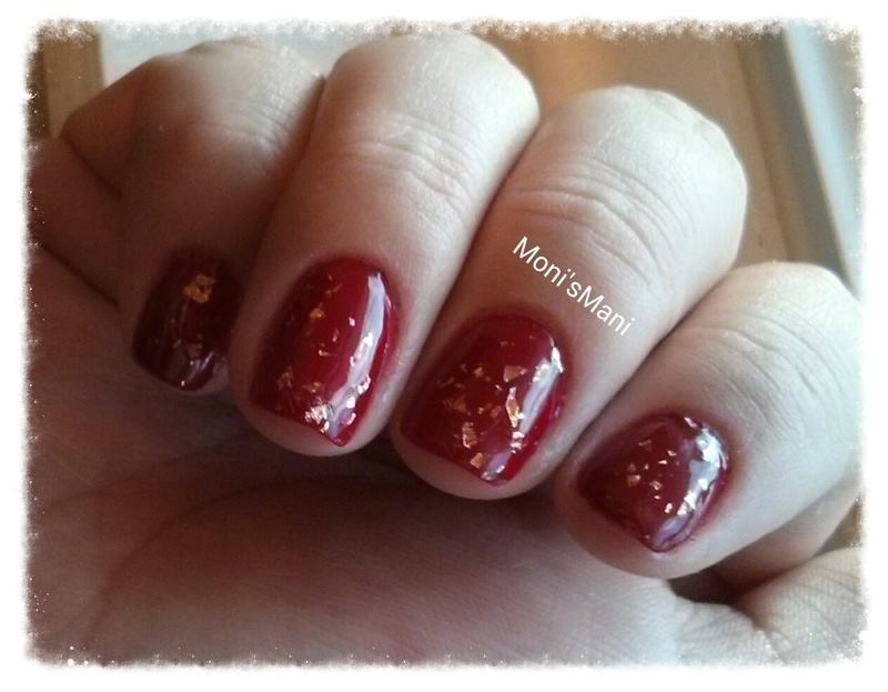 red with gold specs nail art by Moni'sMani