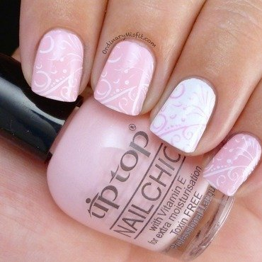 Delicate pink and white nail art by Michelle