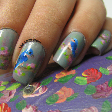 Two little birdies sitting on a tree nail art by Hadas Drukker