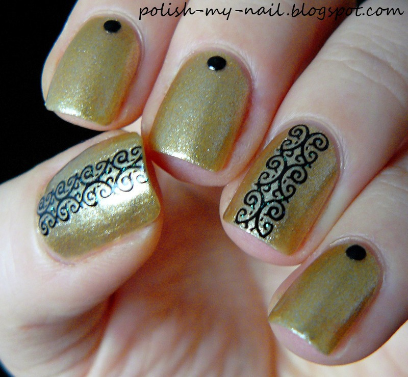 Studs and lace nail art by Ewlyn