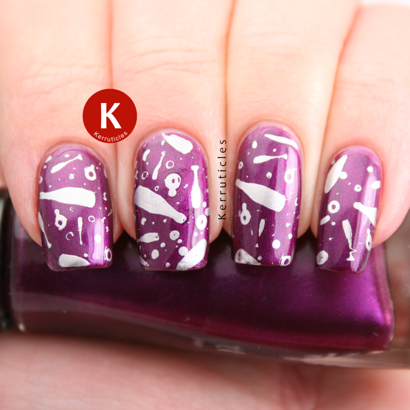 Purple stamped with champagne glasses nail art by Claire Kerr