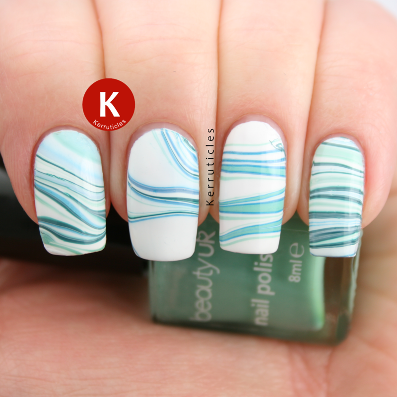 Green and white water marble nail art by Claire Kerr