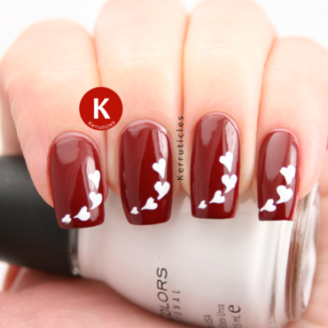 Red and white stencilled hearts  nail art by Claire Kerr