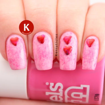 Pink cling film (saran wrap) with red heart studs nail art by Claire Kerr