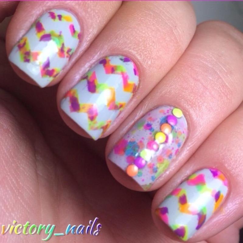 Neon chevrons + studs nail art by Nicole