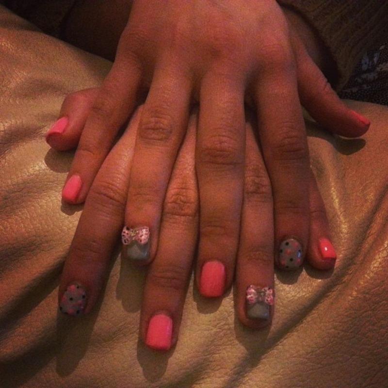 Polka dots and bows nail art by ilovenailsuk