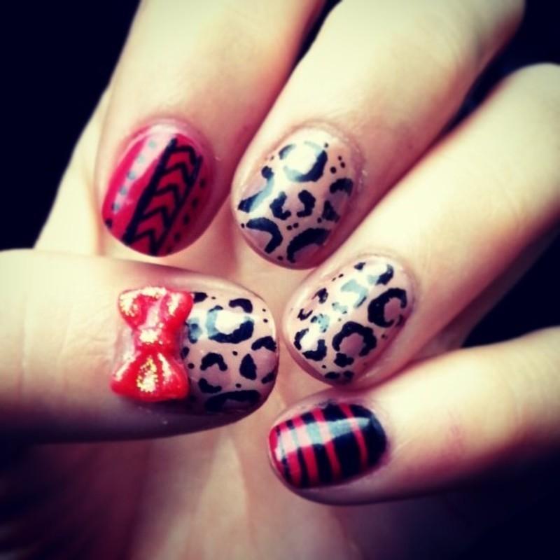 hot cheetah nail art by Ashley Guyaux
