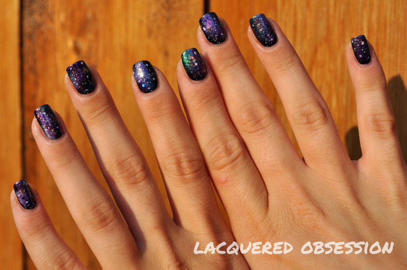 Galaxies and nebulas nail art by Lacquered Obsession