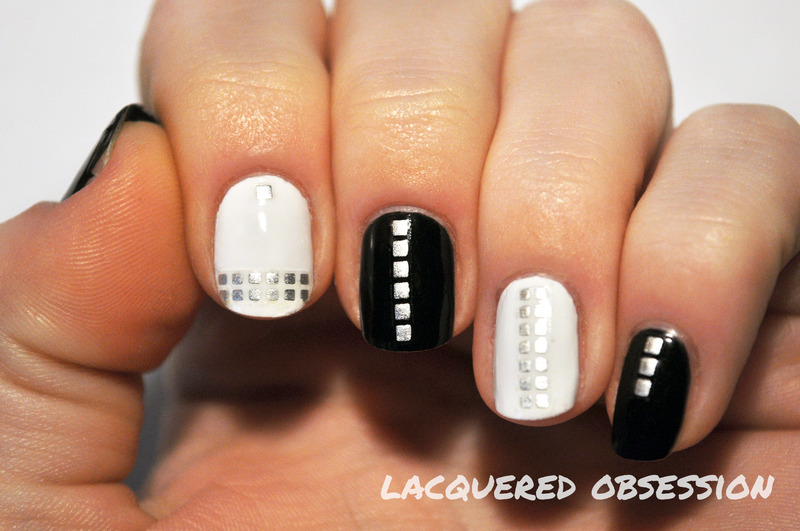 Black, white and studs nail art by Lacquered Obsession