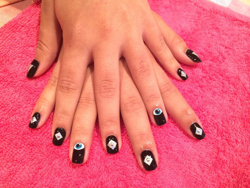 Black diamond eyes nail art by Cami Grimaldi - Nailpolis: Museum of ...