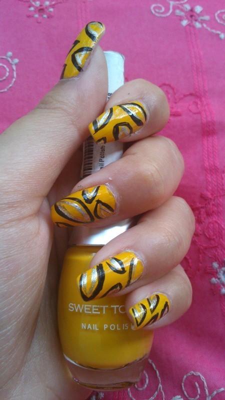 Black and Yellow nail art by Haniya Sajid