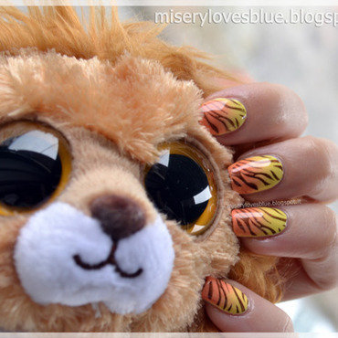 Tigers and the Sun nail art by MiseryLovesBlue