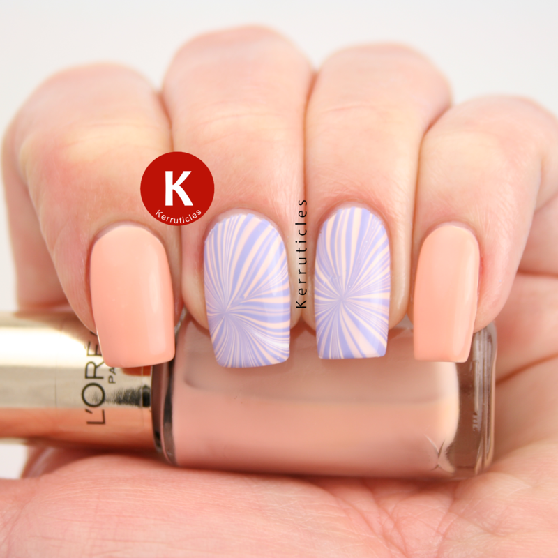 Peach and lilcac pastel water marble nail art by Claire Kerr