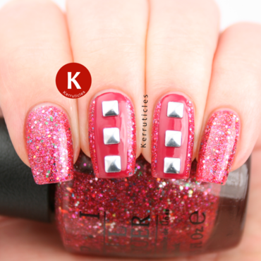 Pink glitter and silver studs nail art by Claire Kerr