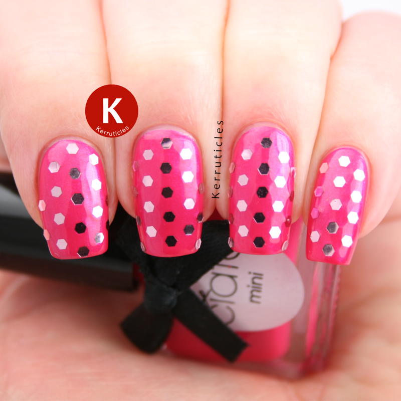 Hot pink with light pink glequin polka dots nail art by Claire Kerr
