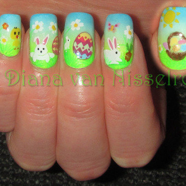 Easter bunnies playing in the garden! nail art by Diana van Nisselroy