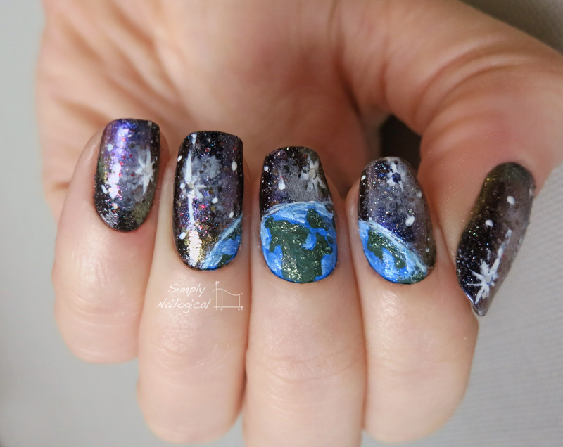 Earth spotted in a galaxy nail art by simplynailogical