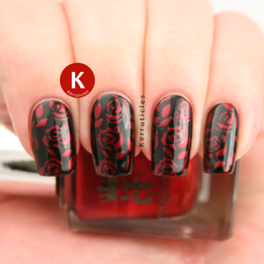 Red roses stamped over black nail art by Claire Kerr