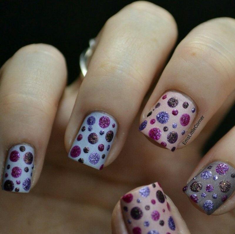 textured dots over a matte base nail art by Emma B