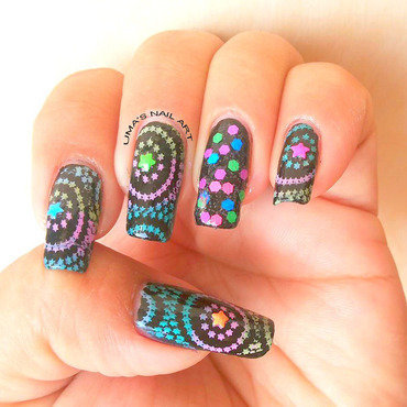 Black Magic nail art by Uma mathur
