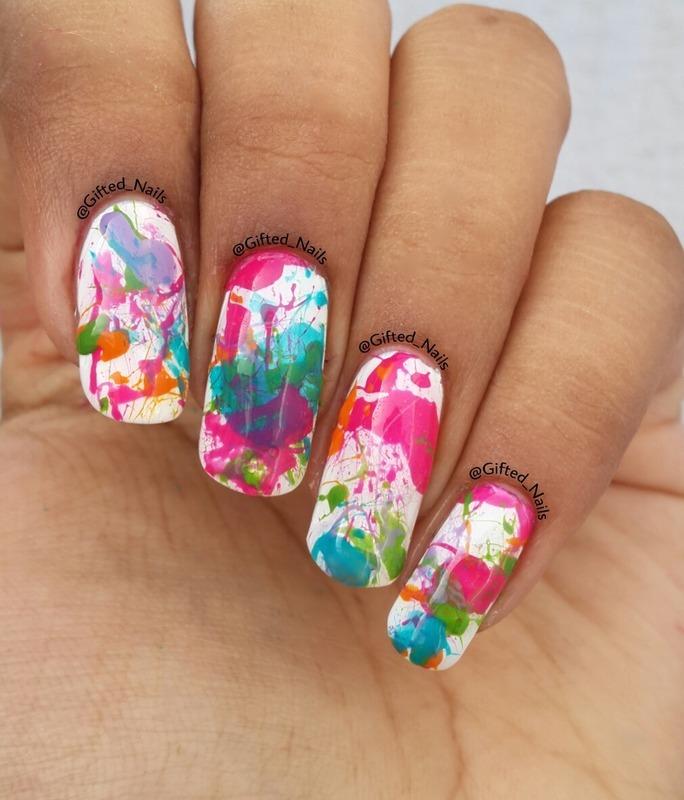 Splatter nails nail art by Gifted_nails