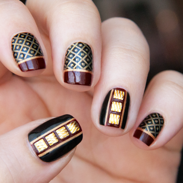 Golden studs nail art by Chasing Shadows
