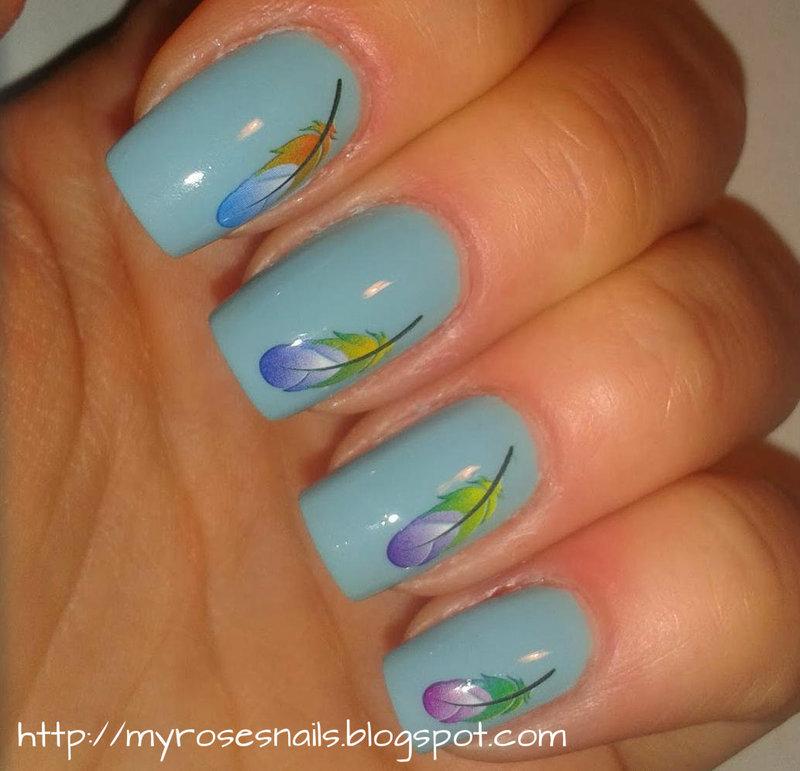 Colorful feathers nail art by Ewa