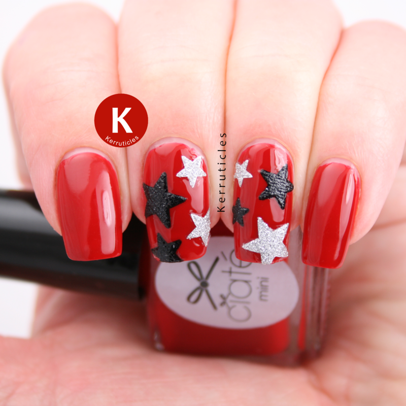 Black and silver sparkly stars over red nail art by Claire Kerr