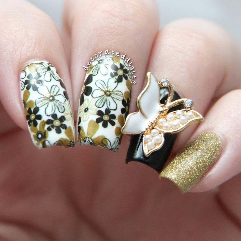 Floral butterfly nail art by Jordan