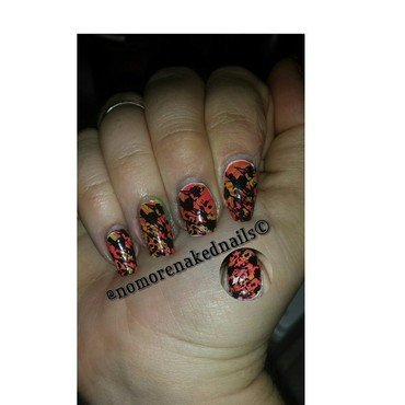 stamping over water marbeling nail art by nomorenakednails