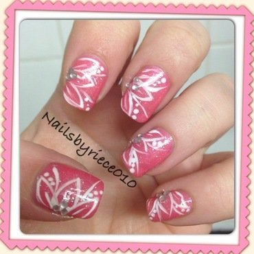 Pink with flowers nail art by Riece